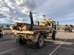 M1081_w_crane_and logs.jpg